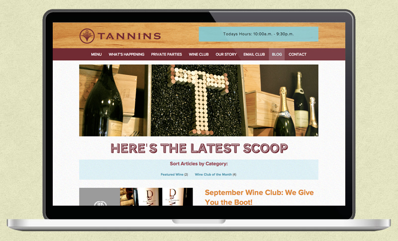 Tannins Wine home page displayed on a laptop screen