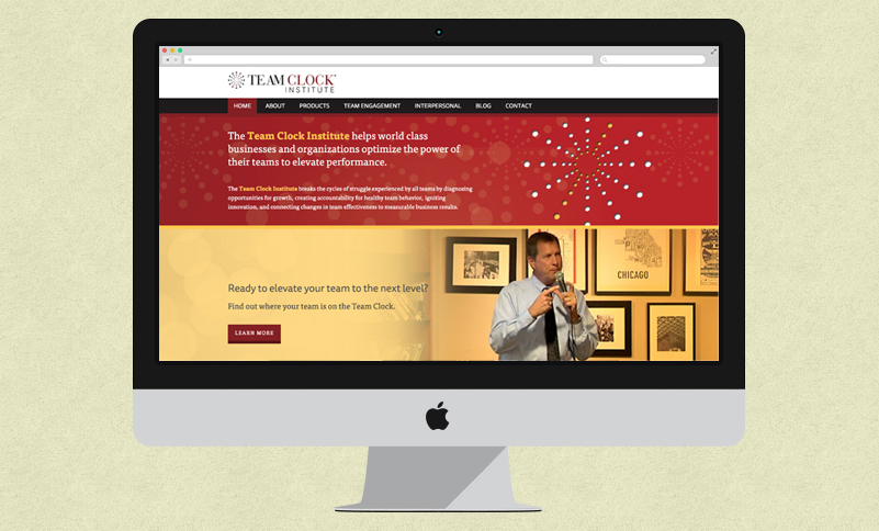 Team Clock Institute's home page displayed on an iMac
